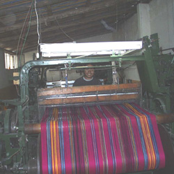 Weaving the cloth.